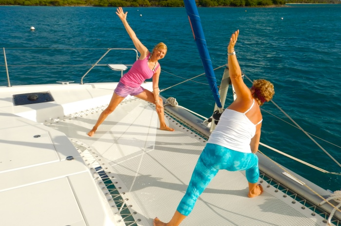 3.1A_ScrubIsland_Slide_8_Morning_Yoga_On_Catamaran_700x465