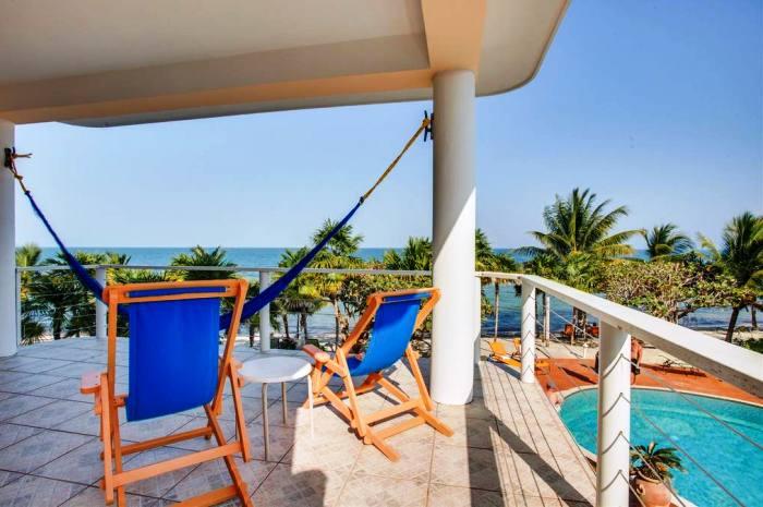 Laru-Beya-Resort-suite-balcony-overlooking-pool-ocean_700x465